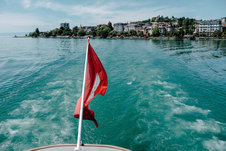 Flag mounted on boat in sea