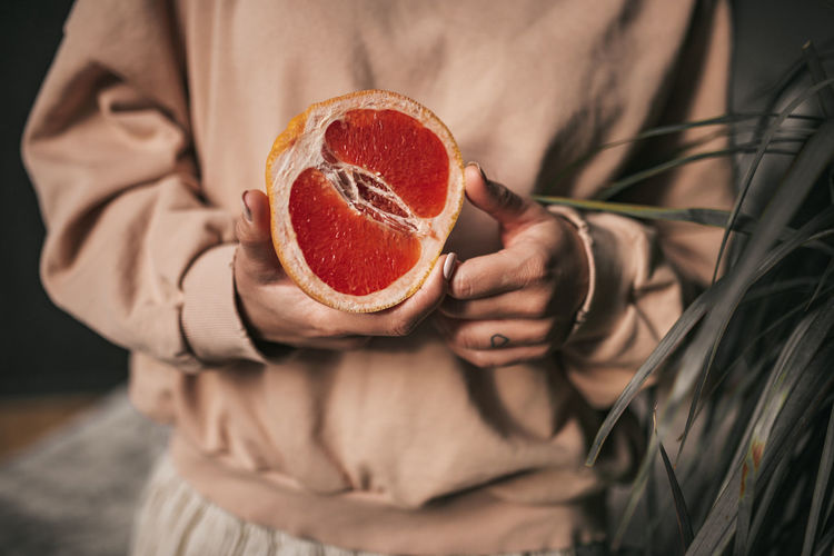 Close-up of woman holding ice cream