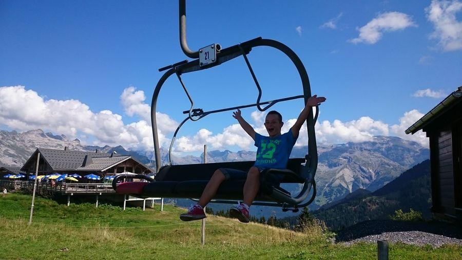 Young Man Enjoying On Ski Lift