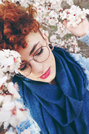 Beautiful Woman Beauty Eyeglasses  Flower Flowering Plant Front View Glasses Hairstyle Headshot Leisure Activity Lifestyles Nature One Person Outdoors Plant Portrait Real People Smiling Young Adult Young Women