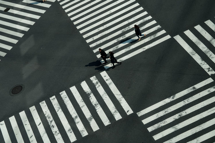 High angle view of people crossing street