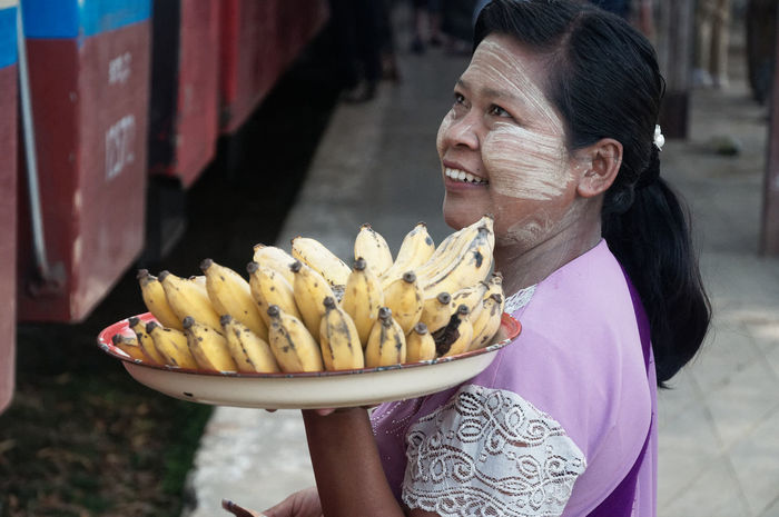 Traveling in the Shan state of Myanmar, Selling fruits on the train to Hsipa Nikon Shan State Day Eating Food Food And Drink Freshness Holding Lifestyles Myanmar One Person Outdoors People Real People Women