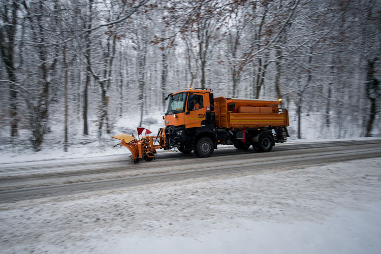 Transportation Cold Temperature Snow Tree Mode Of Transportation Winter Land Vehicle Nature Day Road Forest Frozen Plant Motion Land Outdoors Motor Vehicle No People Snowing Blizzard Snowplow