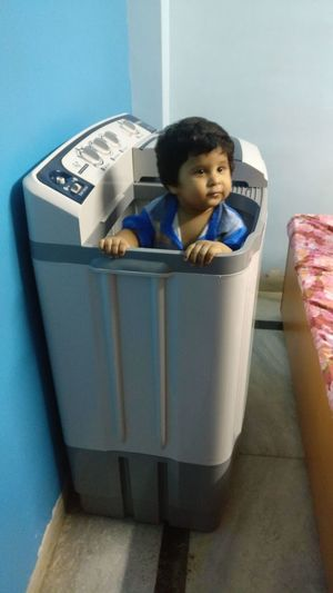 Little Boy Sitting In Washing Machine Playing Playing Alone Child Childhood Children Only One Person Indoors  People Domestic Life