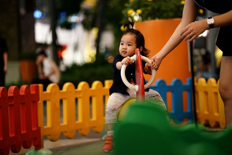 EyeEm Selects One Person Child Childhood People Outdoors Happiness Cute Smiling Playing Females Cheerful Portrait Children Only Day Adult Playground Equipment Playground Playing Field Childhood Memories