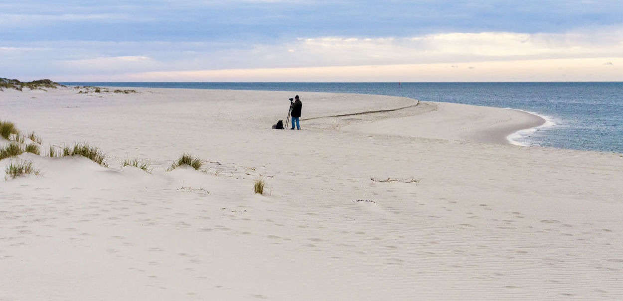 People you meet on the beach.. ;-) Alone Beach Ellenbogen, Sylt Horizon Over Water Nature One Person Outdoors People Photographer Real People Sand Scenics Sea Shore Sky Standing Sylt Sylt, Germany Tranquil Scene Tranquility Travel Destinations Tripod Vacations Water