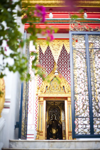 details of a Buddhist temple Arch Buddhism Buddhist Buddhist Temple Colors Creativity Design Focus On Foreground Ornate Place Of Worship Religion Selective Focus Spirituality Temple Temple - Building Window