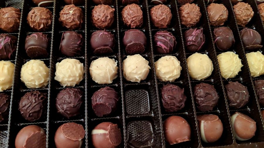 Box of chocolates. Germany Chocolate Chocolates Box Of Chocolates White Chocolate Sweet Sweet Tooth. Diet Life Full Frame Directly Above Tray Backgrounds In A Row Close-up Sweet Food Food And Drink