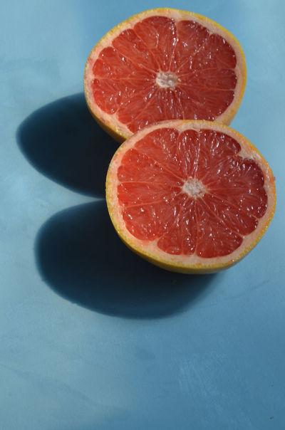 red grapefruit halves Breakfast Time Citrus  Citrus Fruit Close-up Food Freshness Fruit Fruits Grapefruit Healthy Eating Juicy No People Orange - Fruit Orange Color Organic Red Red Grapefruit Ripe Selective Focus Still Life