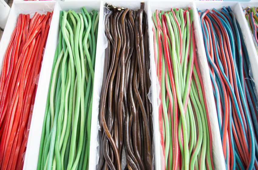 Homemade twisted colorful twisted licorice candies as a background Multi Colored Variation Large Group Of Objects Choice No People Close-up Clothing Business Green Color Industry Fashion Store Order Sugar Candy Shop Nobody Around Retail Market Shop Front Market Stall Selling Spices Various Colors Healthy Eating Foodphotography Food Porn Childhood Children Only