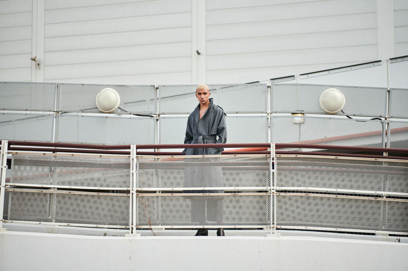 Full length portrait of man standing on boat deck