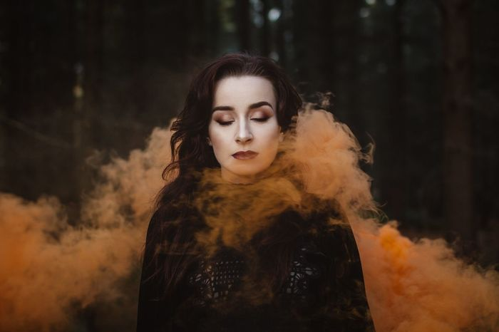 The Portraitist - 2016 EyeEm Awards Portrait Portraits Smoke Smoke Bomb Orange Outdoors Woods Moody Dramatic Girl