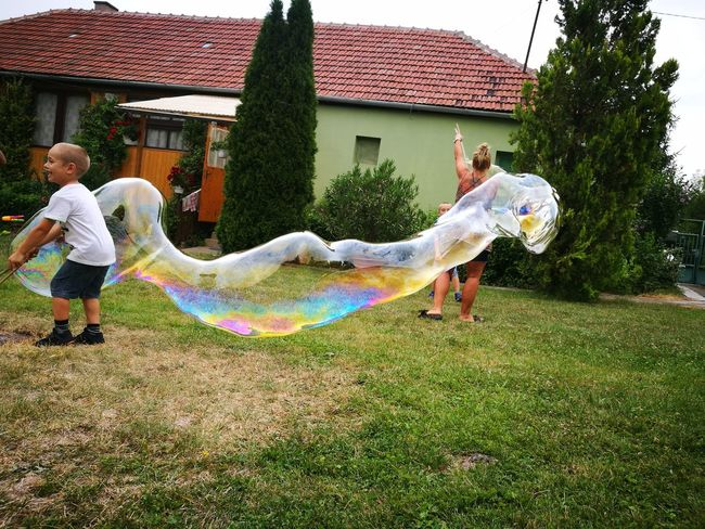 Fun Mid-air Playing Front Or Back Yard Motion Architecture Day Real People Built Structure Outdoors Building Exterior Full Length Bubble Wand Grass People Adult Hungary