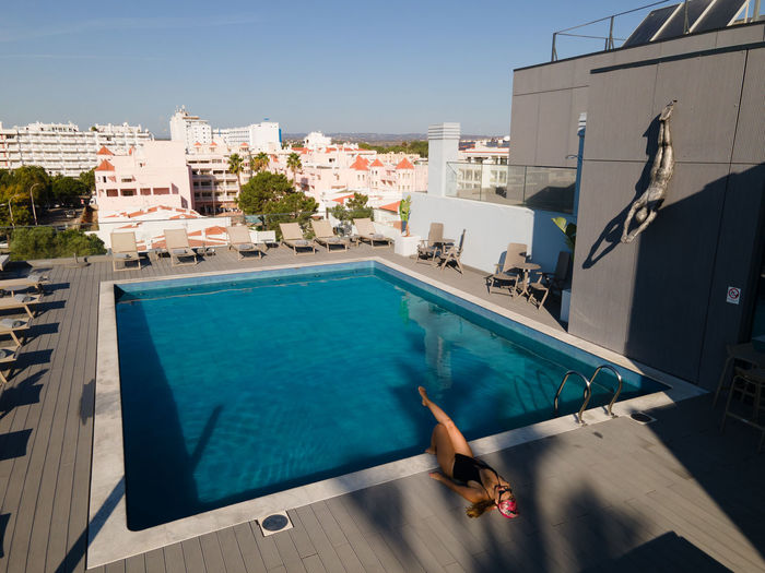 High angle view of swimming pool against buildings in city