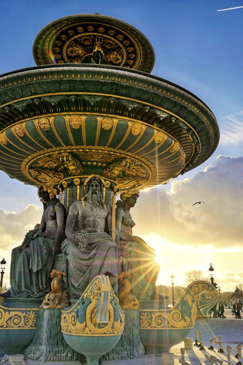 Fontaine des Mers Light Paris Rays Of Light Built Structure City Cloud - Sky Funtain Gold Colored Human Representation Low Angle View Sculpture Statue Street Streetphotography Sunset Travel Destinations Urban