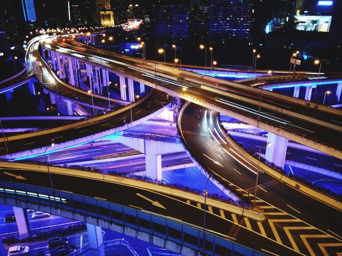High angle view of light trails on bridge