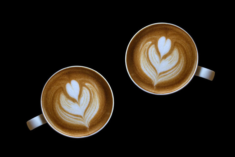 Coffee latte art isolated on black background. Beautiful Isolated Morning Top Barista Black Bubble Caffeine Cappuccino Cappuccino Art Coffee Coffee - Drink Coffee Cup Cup Drink Food And Drink Heart Hot Drink Latte Milk Saucer
