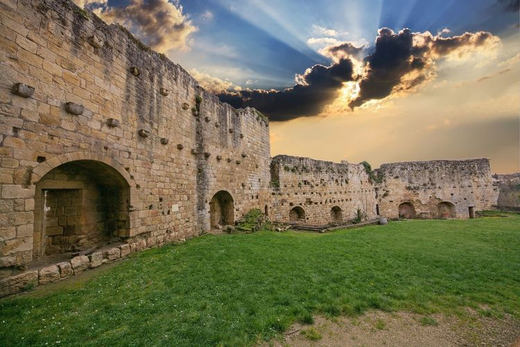 Amphitheater Arch Architecture Building Exterior Built Structure Castle Cloud - Sky Day Fort Fortified Wall Grass History Medieval No People Old Ruin Outdoors Sky Sunset Travel Destinations