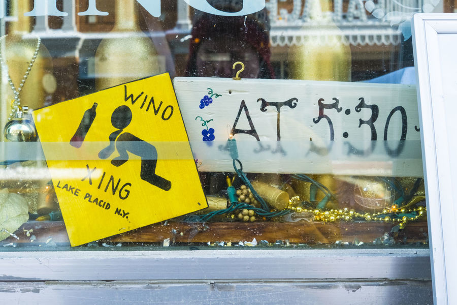 Wino Crossing at 5:30. Be on the lookout! Bars And Restaurants Drink Responsibly Drinking Fun Signs Instructional Signs Moderation Numbers Pubs Signs Street Crossing Western Script Wino Yellow