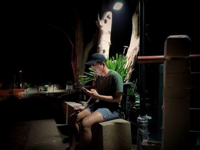 Man smoking in restaurant at night