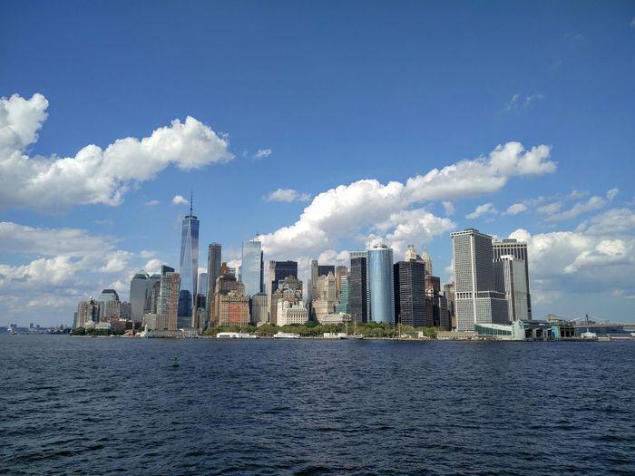 Manhattan skyline on sunny day seen from hudson river