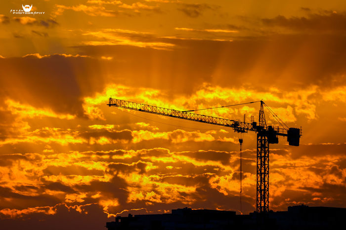 Sun Rise Sunlight Worker And Tools Architecture Built Structure Cloud - Sky Construction Site Crane Crane - Construction Machinery Day Electricity Pylon Low Angle View Nature No People Orange Color Outdoors Silhouette Sky Sunrise Sunset Worker At Work Workers Area Workers At Work