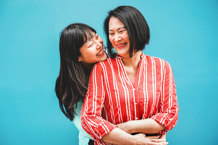 Asian mother and daughter having fun togheter Asian  ASIA Japan China Togetherness Love Emotion Bonding Smiling Women Standing Happiness Family Mother Daughter