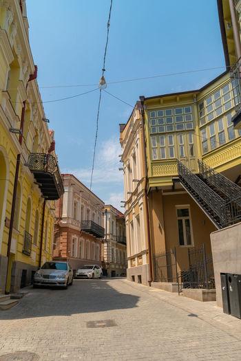Street amidst buildings against sky in city