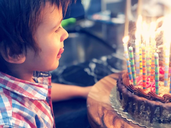 On New Year's Eve this toddler blows out candles on his father's birthday cake. He licks his lips with anticipation. New year occasion expression Anticipation joy Life EyeEm Best Shots EyeEm Selects moments of happiness New Year Occasion Expression Anticipation Joy Life EyeEm Best Shots EyeEm Selects Adorable Cute Toddler  Happiness Burning Fire Flame Candle Child Cake Illuminated Childhood Birthday Birthday Cake Celebration Birthday Candles Lifestyles Indoors  One Person Headshot