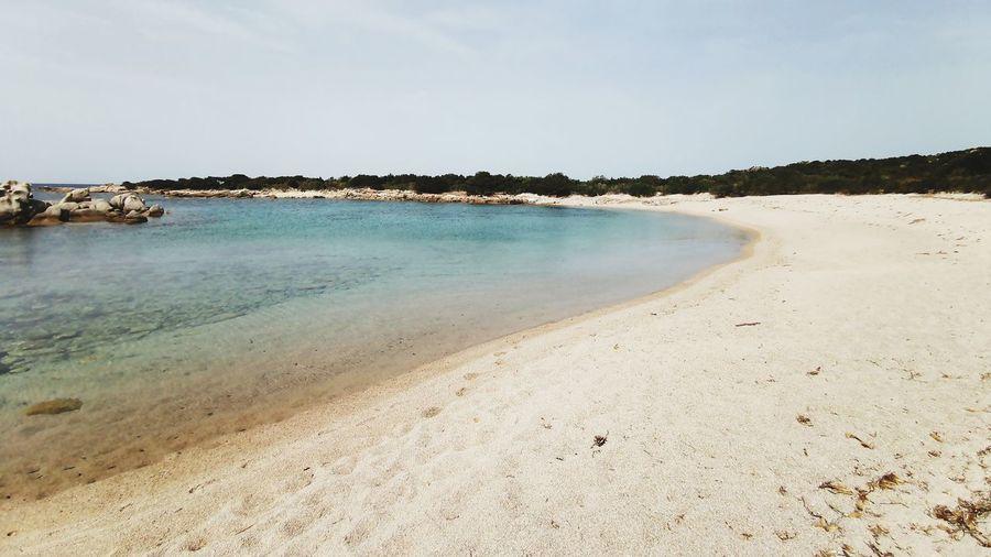 Spiaggia Carletti - Corsica Corsica Baia Spiaggia Carletti Summer Holidays Vacanze Mare Mediterranean Sea Water Sea Beach Clear Sky Sand Horizon Blue Sky Horizon Over Water Landscape