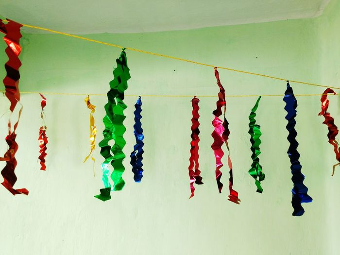 Hanging In A Row Green Color Igniting No People Multi Colored Freshness Day Celebrations Happy Home