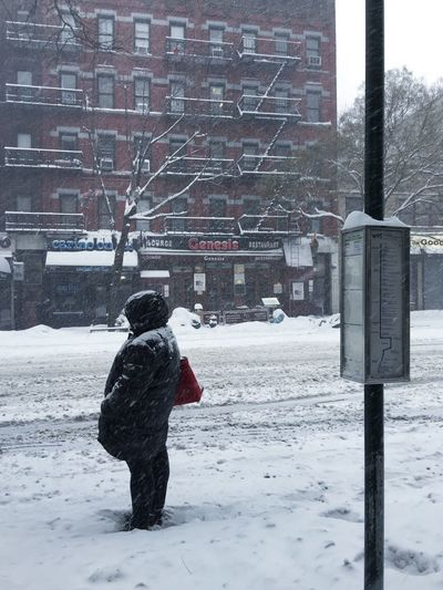 Woman Waiting For The Bus Waiting in the Snow Winter Cold Temperature One Person Real People Warm Clothing Outdoors Lifestyles Full Length City Day Snowing Adult NYC Manhattan Public Transportation Snow Day