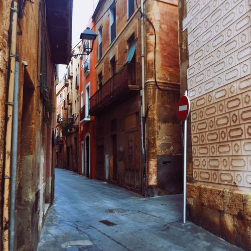 Street of Tarragona, Spain Architecture Built Structure Building Exterior Brick Wall Alley Day The Way Forward No People Outdoors Residential Building City Tarragona Picturesque Street Old Town SPAIN Europe Old Village