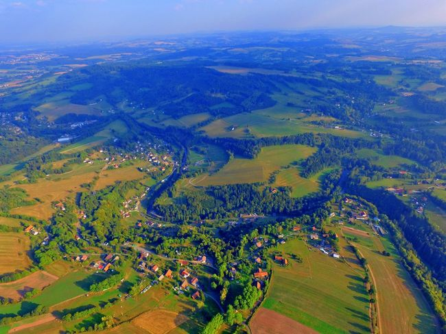 Aerial View Agriculture Beauty In Nature Cultivated Land Day Distant Farm Landscape Mountain Nature Non-urban Scene Outdoors Patchwork Landscape Rural Scene Scenics Sky Tourism Town Tranquil Scene Tranquility Travel Destinations Vacations Wide Wide Shot
