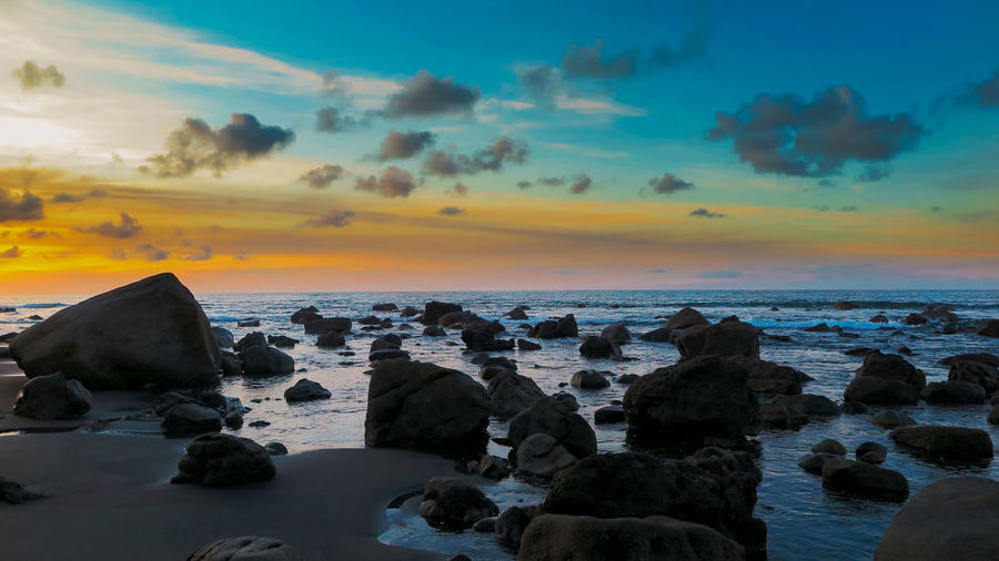 Sunset Sea Rock Water Sky Scenics - Nature Rock - Object Solid Cloud - Sky Horizon Over Water Beauty In Nature Beach Land No People Outdoors Tranquility Nature Horizon Black Sand Beach Black Sand EyeEm Nature Lover EyeEm Gallery Nature Photography Nature_collection Sunset_collection