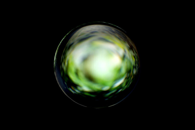 Close-up of glass against black background