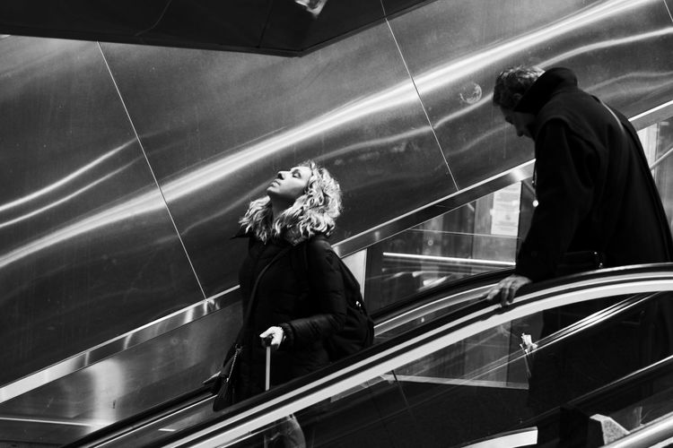 Streetwise Photography Real People Transportation Escalator Women Men Lifestyles Motion People Architecture Mode Of Transportation Adult High Angle View Railing Staircase Travel Indoors  Steps And Staircases Standing darkness and light Opposition Light Opposites Yingyang The Art Of Street Photography The Street Photographer - 2019 EyeEm Awards