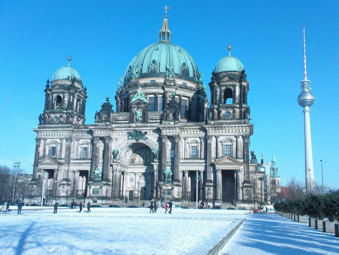 Low angle view of berlin cathedral against sky during winter