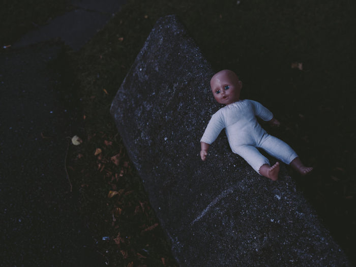 High angle view of cute baby girl on rock