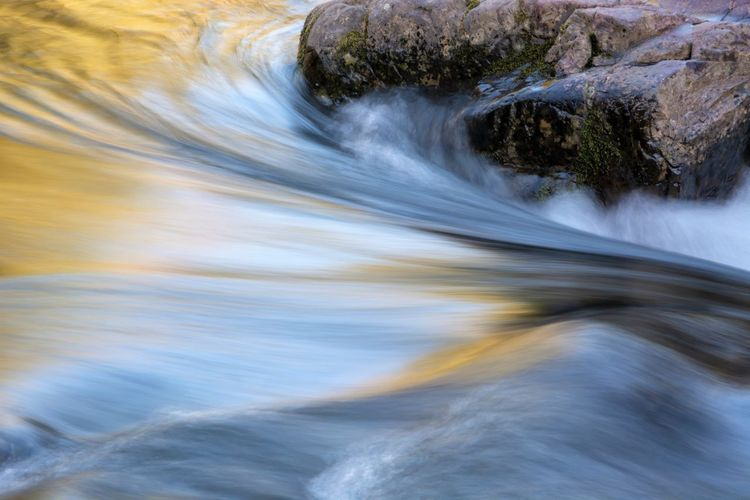 Motion Blurred Motion Long Exposure Water Speed No People Flowing Water Nature Beauty In Nature Day Outdoors Rock Solid Waterfront Waterfall Rock - Object Scenics - Nature Tree River Flowing Purity Falling Water