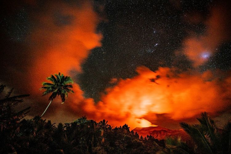Scenic view of fire against sky at night