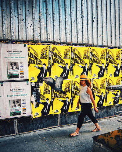Paint The Town Yellow Graffiti Only Women One Person Women City Real People Photographing Check This Out The Week Of Eyeem The Week On Eyem Multi Colored Art Is Everywhere Outdoors Street Photography EyeEm Selects Life Streetphotography Istanbul Peopleandplaces