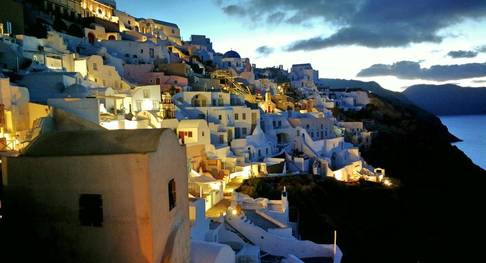 || Nature Theories || A Sunrise at Santorini, Greece. TheFoneFanatic Nokia  Nokia808 Vacations Mobilephotography PhonePhotography Colorful Lowlight Town Hill Illuminated House Sky Architecture TOWNSCAPE Housing Settlement