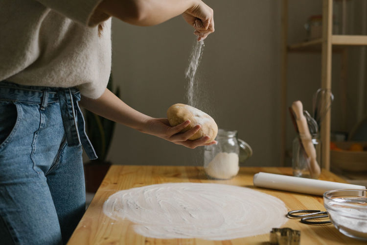 Midsection of woman preparing food