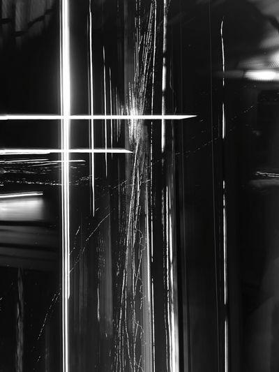 Light trails on glass window at night