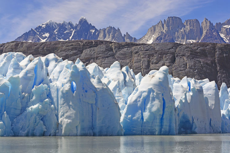 Ice, rocks, and mountains by the grey glacier in torres del paine national park in patagonian, chile