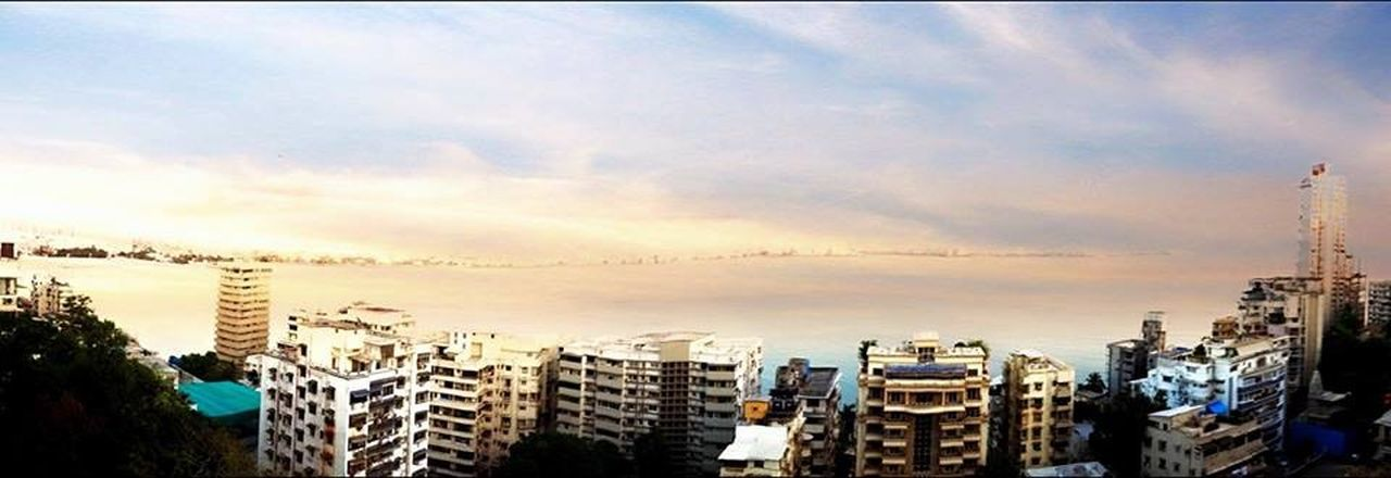 city, building exterior, architecture, cityscape, built structure, skyscraper, city life, cloud - sky, sunset, dramatic sky, sky, urban skyline, no people, apartment, outdoors, modern, community, day