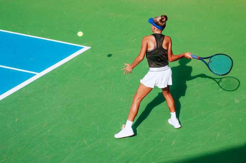 Playing tennis, young athletes, competitive sport, action shot, tennis court