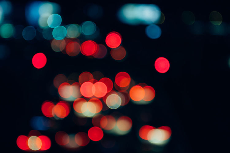 Abstract Backgrounds Black Background Blurred Motion Brightly Lit Circle Defocused Disco Lights Geometric Shape Glowing Illuminated Lens Flare Light Light - Natural Phenomenon Light Effect Lighting Equipment Motion Night No People Pattern Red Shape Street Textured Effect