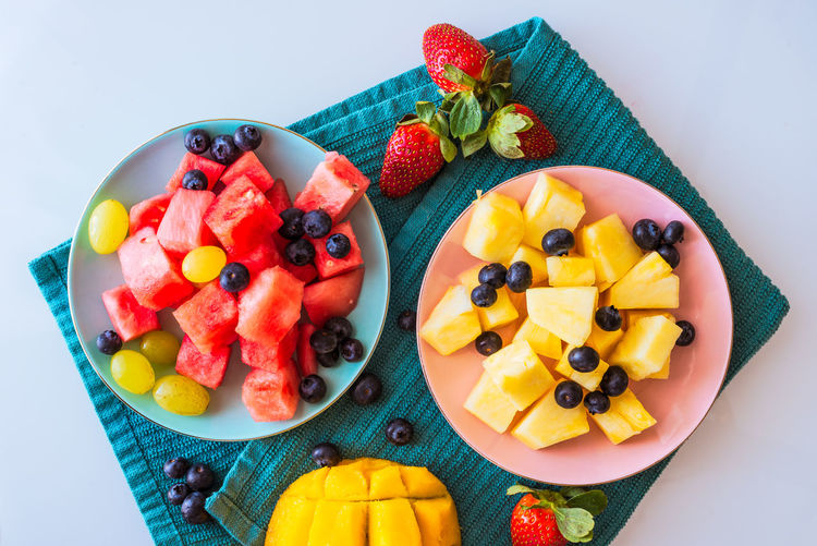 Fruit salad Mango Berry Fruit Blueberry Chopped Food Food And Drink Freshness Fruit Fruit Salad Healthy Eating High Angle View Indoors  No People Plate SLICE Still Life Strawberry Studio Shot Sweet Food Temptation Variation Watermelon Wellbeing